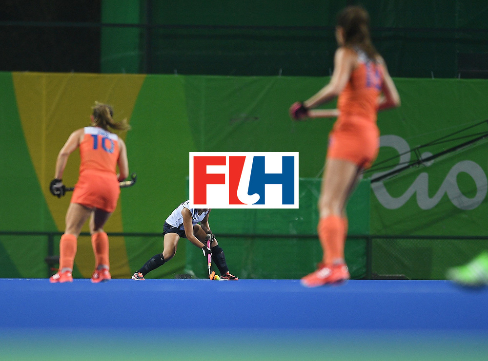 South Korea's Park Kiju (C) hits the ball during the women's field hockey Netherlands vs South Korea match of the Rio 2016 Olympics Games at the Olympic Hockey Centre in Rio de Janeiro on August, 8 2016. / AFP / MANAN VATSYAYANA        (Photo credit should read MANAN VATSYAYANA/AFP/Getty Images)
