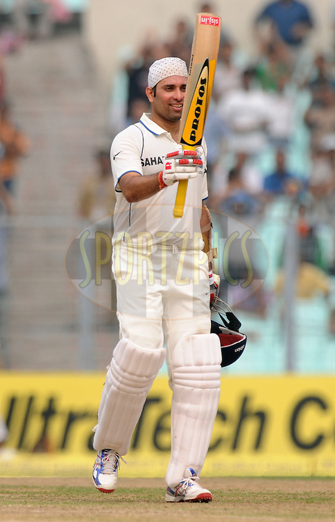 VVS Laxman of India celebrates after hitting a century during the 2nd day of the 2nd test match between India and The West Indies held at Eden gardens in Kolkata, India on the 15th November 2011..Photo by Pal Pillai/BCCI/SPORTZPICS