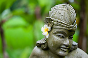 Balinese sculpture with flower
