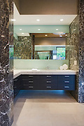 Storage units and mirror in bathroom of California home