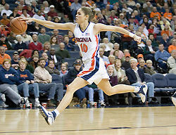 Virginia's Brenna McGuire (10) lunges to save a loose ball from going out of bounds against Wake Forest.  The Cavaliers defeated the Demon Deacon 77-71 on January 11, 2007 for their first ACC win in the John Paul Jones Arena in Charlottesville, VA.<br />