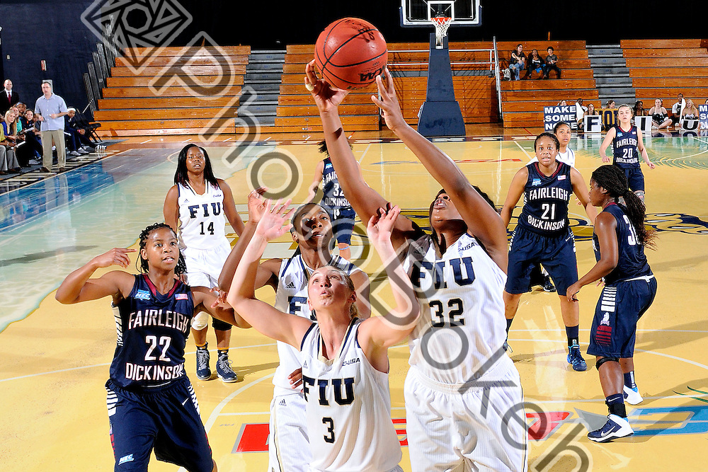 2013 December 28 - FIU's Zsofia Labady (3) and Tynia McKinzie (32). Florida International University defeated Fairleigh Dickinson, 79-57, at US Century Bank Arena, Miami, Florida. (Photo by: Alex J. Hernandez / photobokeh.com) This image is copyright by PhotoBokeh.com and may not be reproduced or retransmitted without express written consent of PhotoBokeh.com. ©2013 PhotoBokeh.com - All Rights Reserved