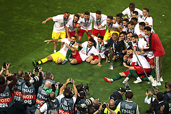 Portugal players and manager Fernando Santos celebrate with the Nations League Trophy after the Nations League Final at Estadio do Dragao, Porto.
