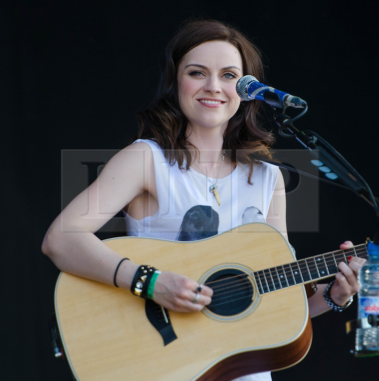 """© Licensed to London News Pictures. 03/08/2012. London, UK.  Amy McDonald performs live at BT London Live, Hyde Park.  Amy Macdonald (born 25 August 1987 in Bishopbriggs, East Dunbartonshire) is a Scottish recording artist. Macdonald rose to fame in 2007 with her debut album, This Is the Life (2007) and its fourth single, """"This Is the Life"""". The single charted at number one in six different countries worldwide, and charted inside the top ten in another eleven countries worldwide.  Photo credit : Richard Isaac/LNP"""