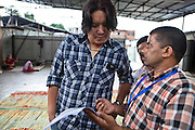 A Nepalese GoodWeave Foundation inspector discusses his report with the owner of R.C. Rug Factory in Narayanthan, Kathmandu, Nepal.  His assessment has confirmed that the factory maintains good working standards.  The factory export carpets to Europe the U.S and Canada, and rely on the GoodWeave certificate of approval to boast excellent quality and fair conditions for its workers. GoodWeave aim to protect workers rights as the carpet factory industry in Nepal is notorious for providing poor working conditions and forcing young children into labour.