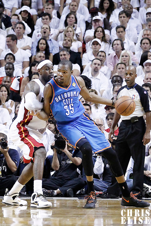 21 June 2012: Oklahoma City Thunder small forward Kevin Durant (35) posts up Miami Heat small forward LeBron James (6) during the Miami Heat 121-106 victory over the Oklahoma City Thunder, in Game 5 of the 2012 NBA Finals, at the AmericanAirlinesArena, Miami, Florida, USA. The Miami Heat wins the series 4-1.