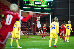 LLANELLI, WALES - Wednesday, April 9, 2014: Wales' captain Jessica Fishlock sees her free-kick saved by Ukraine's goalkeeper Iryna Zvarych during the FIFA Women's World Cup Canada 2015 Qualifying Group 6 match at Parc-y-Scarlets. (Pic by David Rawcliffe/Propaganda)