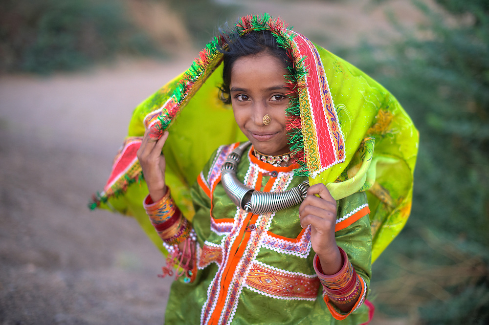 A girl, who is attending a local wedding, in the traditional costume of Harijans of Kutch.<br /> Kutch (Kachchh), Gujarat, India