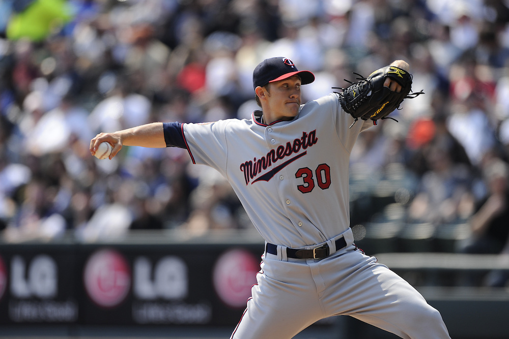 CHICAGO - APRIL 10:  Scott Baker #30 of the Minnesota Twins pitches against the Chicago White Sox on April 10, 2010 at U.S. Cellular Field in Chicago, Illinois.  The Twins defeated the White Sox 2-1.  (Photo by Ron Vesely)