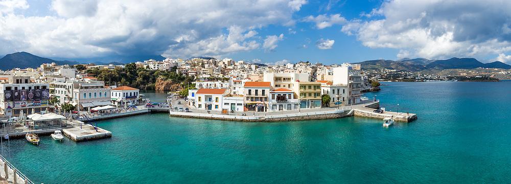 The port of Agios Nikolaos, Crete with Voulismeni Lake in the background.