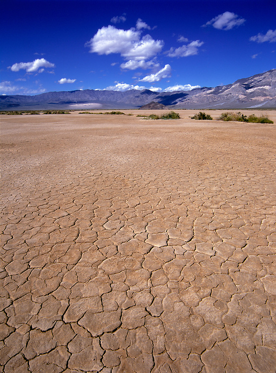 Dried mud flats cover the valley floor near the Panamint Mountains in Death Valley National Park in California.