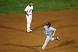OAKLAND, CA - SEPTEMBER 09:  Norichika Aoki #8 of the Seattle Mariners rounds the bases past Marcus Semien #10 of the Oakland Athletics after hitting a home run during the third inning at the Oakland Coliseum on September 9, 2016 in Oakland, California. The Seattle Mariners defeated the Oakland Athletics 3-2. (Photo by Jason O. Watson/Getty Images) *** Local Caption *** Norichika Aoki; Marcus Semien