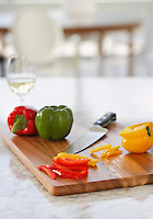 Peppers on chopping board in kitchen