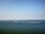 Nederland, Flevoland, Markermeer, 26-08-2019; Marker Wadden in het Markermeer. Houtribdijk in de verre achtergrond.<br /> Doel van het project van Natuurmonumenten en Rijkswaterstaat is natuurherstel, met name verbetering van de ecologie in het gebied, in het bijzonder de kwaliteit van bodem en water<br /> Naast het hoofdeiland is er inmiddels een tweede eiland in wording, de uiteindelijk Marker Wadden archipel zal uit vijf eilanden bestaan. <br /> Marker Wadden, artifial islands. The aim of the project is to restore the ecology in the area, in particular the quality of soil and water.<br /> The first phase of the construction, the main island, is finished. <br /> <br /> luchtfoto (toeslag op standard tarieven);<br /> aerial photo (additional fee required);<br /> copyright foto/photo Siebe Swart