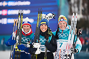 PYEONGCHANG-GUN, SOUTH KOREA - FEBRUARY 10: Marit Bjoergen of Norway, Charlotte Kalla of Sweden and Krista Parmakoski of Finland on the podium after the Ladies Cross Country Skiing 7.5km + 7.5km Skiathlon on day one of the PyeongChang 2018 Winter Olympic Games at Alpensia Cross-Country Centre on February 10, 2018 in Pyeongchang-gun, South Korea. Photo by Nils Petter Nilsson/Ombrello     <br /> ***BETALBILD***