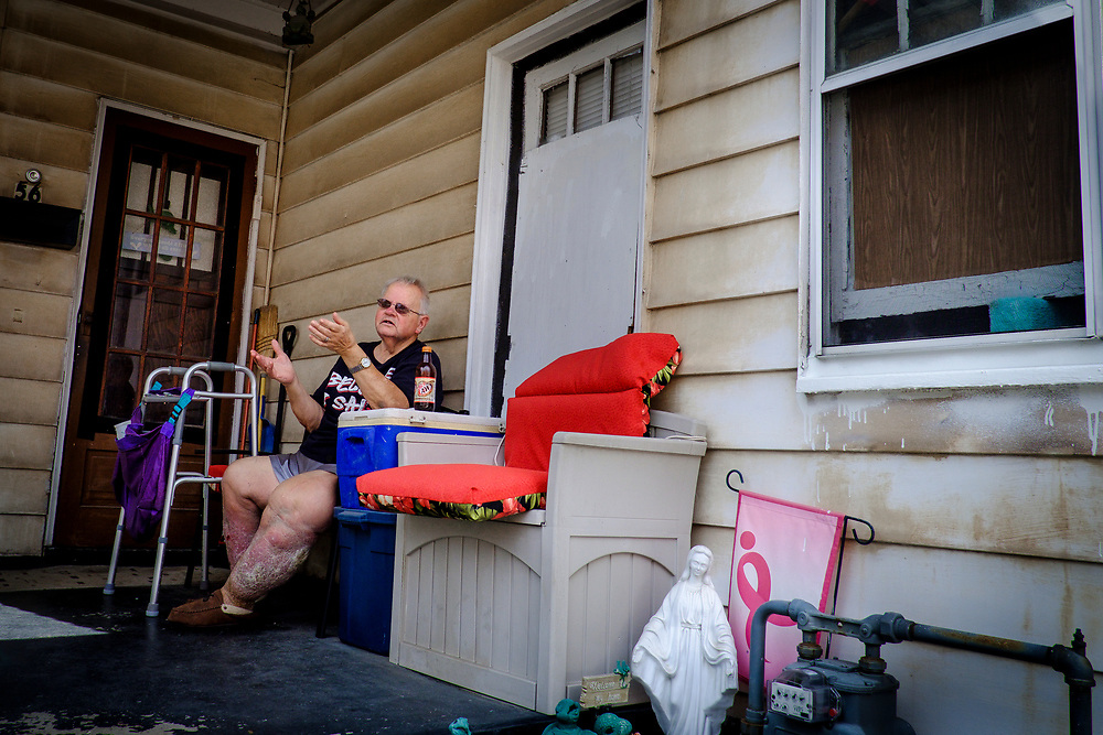 Michael D'Amico sits on his front porch in Natrona, Pa. D'Amico worked at Allegheny Ludlum's Brackenridge plant for 30 years.