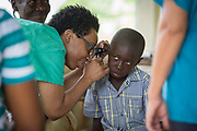 Haitian boy is seen by clinic doctor
