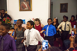 Students march in to the Paso Doble in escort postition.  Dancing Classrooms Virgin Islands culminating event at the Government House Ballroom in Christiansted.  St. Croix, USVI.  18 December 2015.  © Aisha-Zakiya Boyd