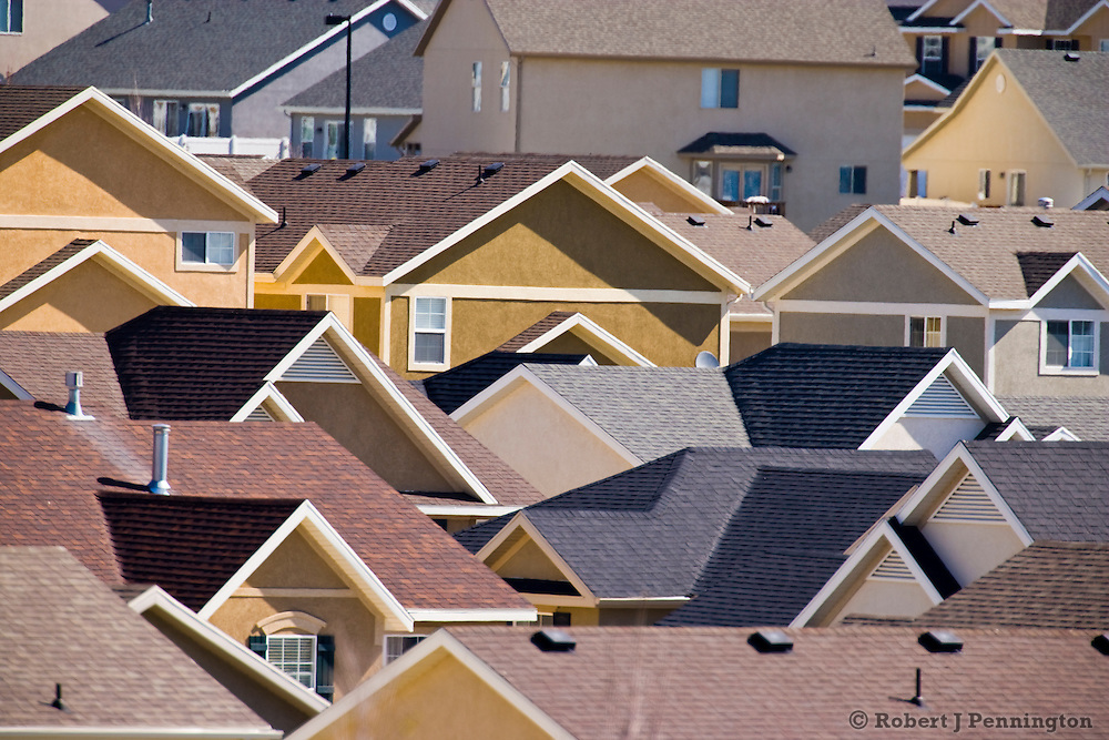 Rooftops of urban sprawl create a sea of geometric patterns in this newly developed community.