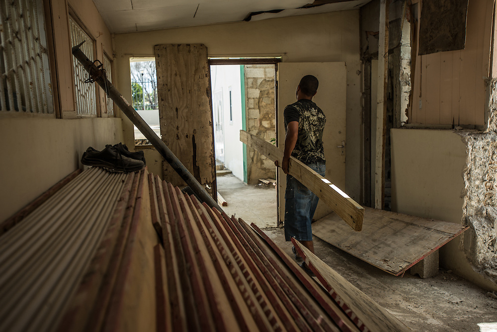 """WILLEMSTAD, CURAÇAO - OCTOBER 24, 2016: A Venezuela man who asked for his identity to be protected in fear of reprisals from authorities works at a construction site in Curaçao. He came to Curaçao to escape the economic crisis and to work illegally here to provide for his family. He can make more in one day working construction in Curaçao than he can in an entire month in Venezuela.  Curaçao, along with Aruba and Colombia and Brazil, are countries receiving a spike in undocumented migrants from Venezuela. The small Caribbean islands neighboring Venezuela say they simply cannot absorb the onslaught. The closest to Venezuela's coast, Aruba and Curaçao, have effectively sealed their borders to poor Venezuelans since last year by making them show $1,000 in cash before entering — the equivalent of more than five years of earnings in a minimum wage job. Both countries have increased patrols and deportations, and Aruba has even set aside a stadium to hold as many as 500 Venezuelan migrants after they are caught. It's a dramatic reversal of fortune for Venezuelans, who once went to Curaçao to spend money as tourists, not to plead for work.  But perhaps most startling are the Venezuelans now fleeing by sea, an image so symbolic of the perilous journeys to escape Cuba or Haiti — but not oil-rich Venezuela. """"It has all totally changed,"""" said Ivan de la Vega, a sociologist at the Central University of Venezuela. He added that about 160,000 Venezuelans have fled the country in the last year alone, about 60 percent more than the number who left the year before. """"The earnings of these people are low,"""" Mr. de la Vega said of the recent migrants. """"The only option left to them is the nearby countries, ones they can get to on foot, or by rafts, or go on boats with tiny motors."""" Inflation will hit a mind-boggling 1,600 percent this year, the International Monetary Fund estimates, shriveling salaries and creating a new class of poor Venezuelans who have abando"""