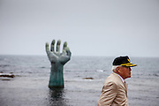 """Visitor at the """"Hand of Harmony"""" located at Homigot Beach close to Pohang city at the South Korean East coast. South Korea"""