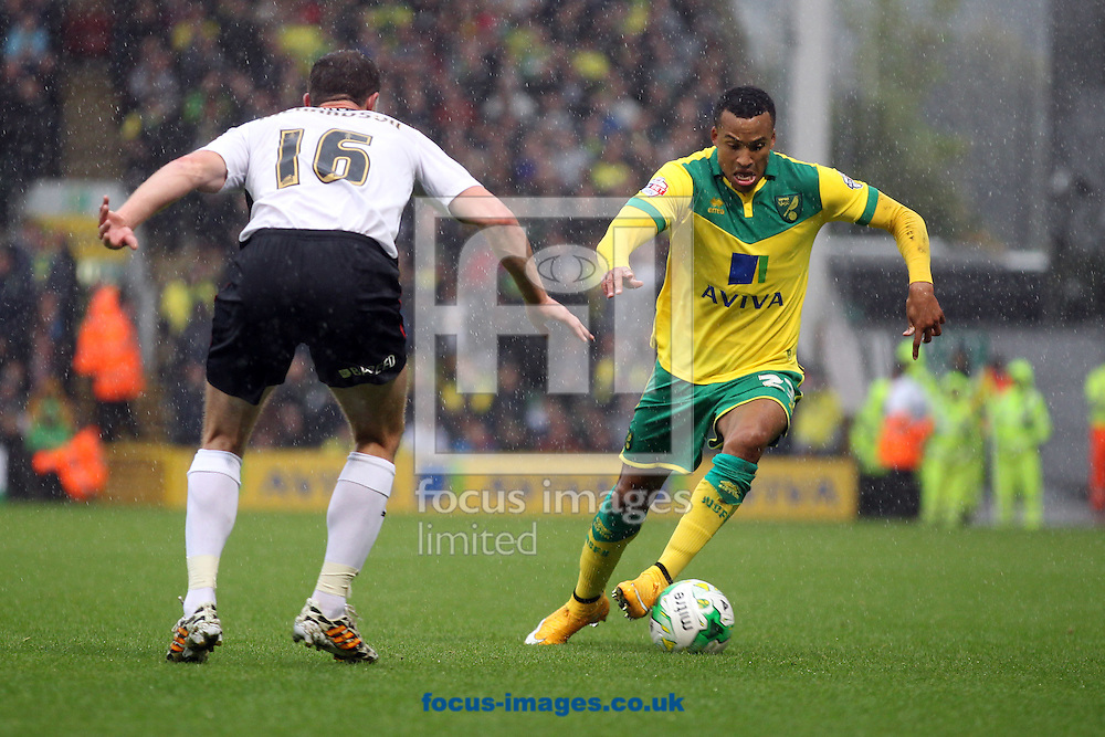 Martin Olsson of Norwich and Frazer Richardson of Rotherham United in action during the Sky Bet Championship match at Carrow Road, Norwich<br /> Picture by Paul Chesterton/Focus Images Ltd +44 7904 640267<br /> 04/10/2014