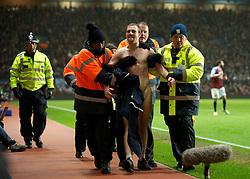 BIRMINGHAM, ENGLAND - Sunday, February 12, 2012: A streaker runs onto the pitch during the Premiership match between Aston Villa and Manchester City at Villa Park. (Pic by David Rawcliffe/Propaganda)