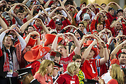 Ohio State Buckeyes fans cheer before kickoff against the Oregon Ducks at the College Football Playoff National Championship Game at AT&T Stadium on January 12, 2015 in Arlington, Texas.  (Cooper Neill for The New York Times)