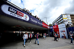 Fans walk under a walkway with Sky Bet boards ahead of the Championship Playoff Final at Wembley - Mandatory by-line: Robbie Stephenson/JMP - 27/05/2019 - FOOTBALL - Wembley Stadium - London, England - Aston Villa v Derby County - Sky Bet Championship Play-off Final