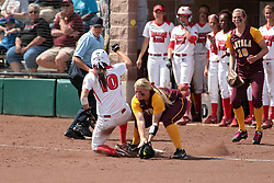09 May 2014:  Laura Canopy slides safely into 3rd base covered by Lauren Moore, backed up by Brittany Gardner during an NCAA Missouri Valley Conference (MVC) Championship series women's softball game between the Loyola Ramblers and the Illinois State Redbirds on Marian Kneer Field in Normal IL