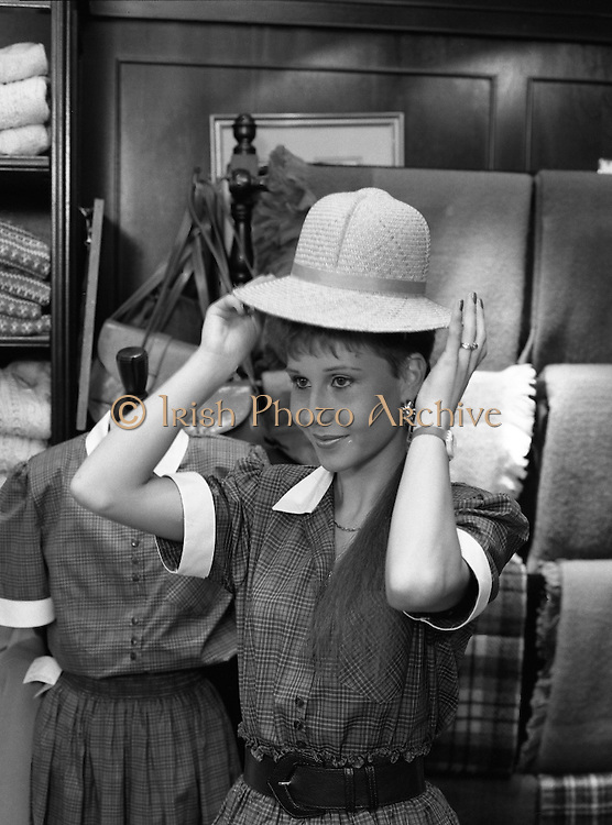 Lydia Roche Fashion Model.   (R76)..1988..19.04.1988..04.19.1988..19th April 1988..Model Lydia Roche returned to a reception at the Blarney Woolen Mills,the place from where she launched her modeling career...Image shows Lydia trying on a stylish had from the extensive range in the Blarney Woolen Mills.