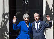 UNITED KINGDOM, London: 24 July 2019 British Prime Minister Theresa May and her husband Philip wave goodbye to members of the media after her final speech as British Prime Minister. After speaking Theresa May was driven to Buckingham Palace where she will officially hand her resignation in to Her Majesty The Queen this afternoon. <br /> Rick Findler / Story Picture Agency