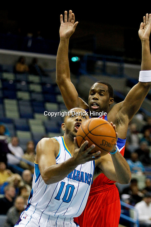 January 4, 2012; New Orleans, LA, USA; New Orleans Hornets shooting guard Eric Gordon (10) shoots overPhiladelphia 76ers guard Jodie Meeks (20) during the first quarter of a game at the New Orleans Arena.   Mandatory Credit: Derick E. Hingle-US PRESSWIRE