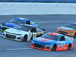 October 14, 2018 - Talladega, AL, U.S. - TALLADEGA, AL - OCTOBER 14: Darrell Wallace Jr., Richard Petty Motorsports, Chevrolet Camaro Medallion Bank/Petty's Garage (43), Brendan Gaughan, Beard Motorsports, Chevrolet Camaro Beard Oil Distributing / South Point Hotel & Casino (62) and Kyle Larson, Chip Ganassi Racing, Chevrolet Camaro Credit One Bank (42) race three wide during the 1000Bulbs.com 500 on October 14, 2018, at Talladega Superspeedway in Tallageda, AL.(Photo by Jeffrey Vest/Icon Sportswire) (Credit Image: © Jeffrey Vest/Icon SMI via ZUMA Press)