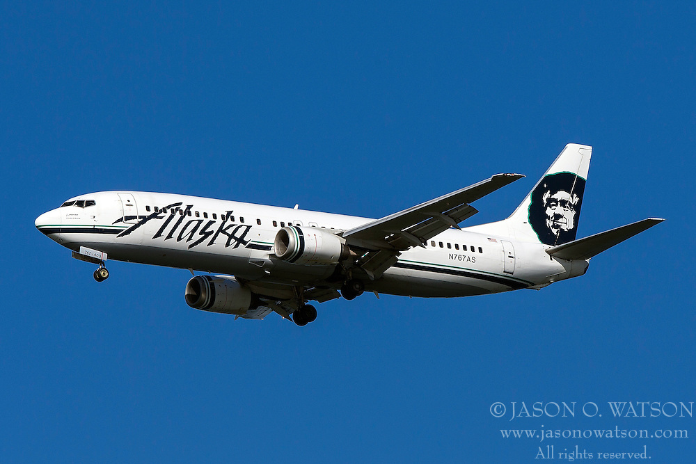 Alaska Airlines Boeing 737-490 (registration N767AS) approaches San Francisco International Airport (SFO) over San Mateo, California, United States of America
