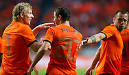 NETHERLANDS, Amsterdam In action Dirk Kuyt (l) Ibrahim Afellay reacts after the 6-0 with Jonh Heitinga (r)The Netherlands versus Northern Irland during friendly soccer match between Netherlands vs Northern Irland in Rotterdam on June 2, 2012. AFP PHOTO/ ROBIN UTRECHT