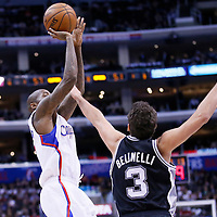 16 December 2013: Los Angeles Clippers shooting guard Jamal Crawford (11) takes a jumpshot over San Antonio Spurs shooting guard Marco Belinelli (3) during the Los Angeles Clippers 115-92 victory over the San Antonio Spurs at the Staples Center, Los Angeles, California, USA.
