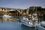Commercial fishing boats docked in the world's smallest natural navigable harbor, at Depoe Bay, Oregon Coast