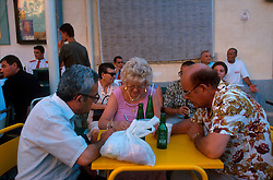MALTA GOZO SANNAT JUL00 - Locals enjoy soft drinks and debate prior to the procession during the Sannat Fiesta.. . jre/Photo by Jiri Rezac. . © Jiri Rezac 2000. . Tel:   +44 (0) 7050 110 417. Email: info@jirirezac.com. Web:   www.jirirezac.com