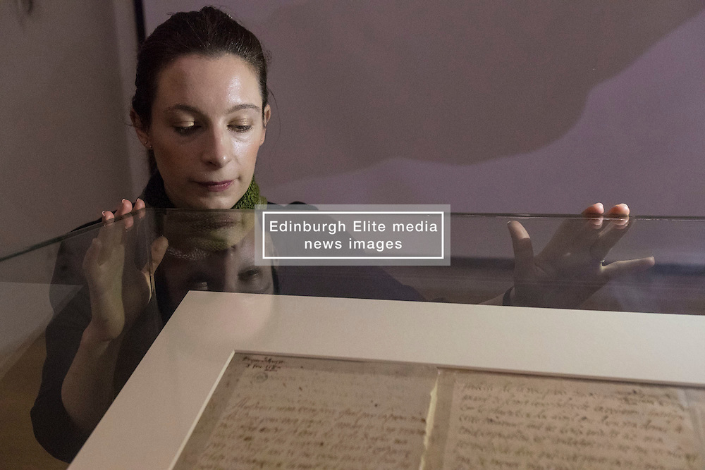 """The last letter of Mary Queen of Scots written just six hours before her execution is on public display at the National Library of Scotland on the 430th anniversary of her death.<br /> <br /> The letter was written at 2am on 8 February 1857 as Mary prepared to meet her death at Fotheringay Castle. Writing to Henri III, King of France, the brother of her first husband, she says """"I am to be executed like a criminal at eight in the morning"""".<br /> <br /> The letter is pictured with Ciara McDermott, Exhibitions Office at the NLS."""