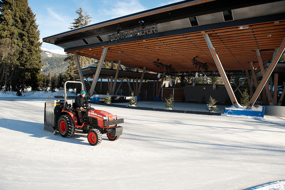 An RMOW employee cleans the ice rink at the Whistler Olympic Plaza.  Sunday, Jan 15, 2017.<br /> <br /> Photo:  David Buzzard