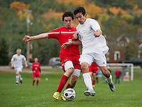Laconia's Patrick Guyer and Gilford's Dan Dormody charge the ball during NHIAA Division III soccer Wednesday afternoon.  (Karen Bobotas/for the Laconia Daily Sun)