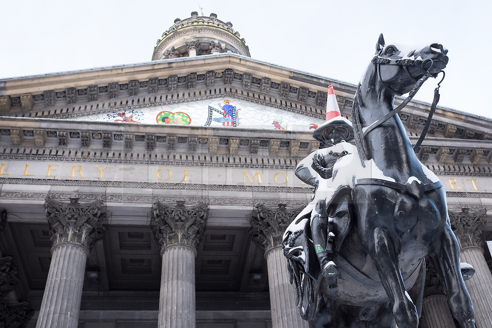 """© Licensed to London News Pictures. 28/02/2018. <br /> <br /> The Duke of Wellington statue retains it's cone as Glasgow, Scotland is hit with snow storm """"Beast from the East"""" on 28th February 2018.<br /> <br /> Photo credit should read Max Bryan/LNP"""
