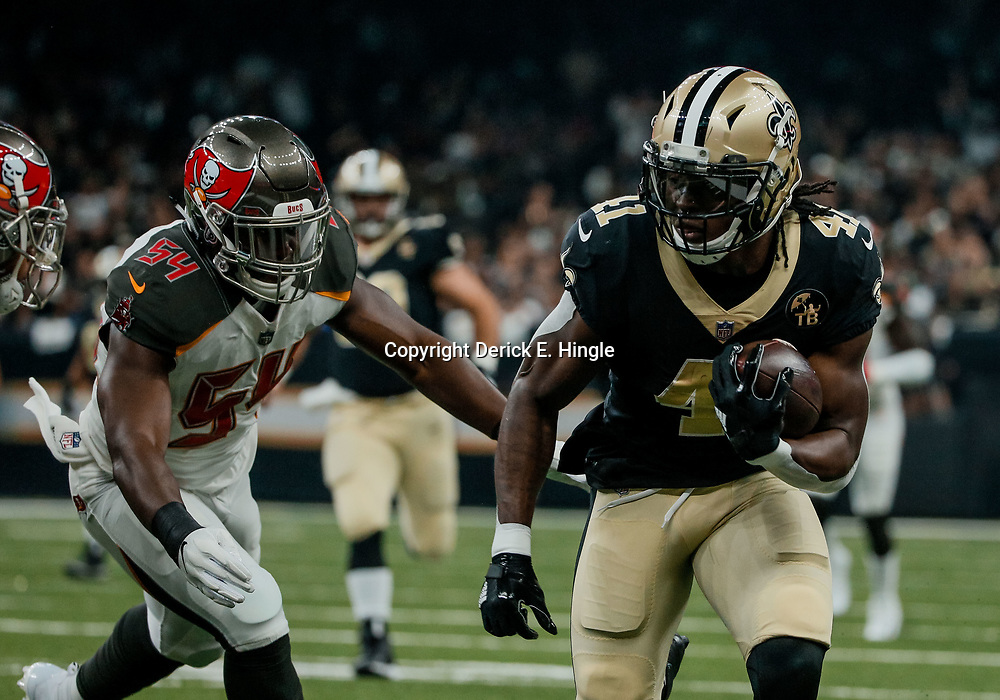 Sep 9, 2018; New Orleans, LA, USA; New Orleans Saints running back Alvin Kamara (41) runs past Tampa Bay Buccaneers linebacker Lavonte David (54) during the first quarter of a game at the Mercedes-Benz Superdome. Mandatory Credit: Derick E. Hingle-USA TODAY Sports