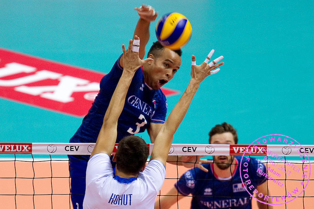 (L) Gerald Hardy Dessources from France attacks against Emanuel Kohut from Slovakia during the 2013 CEV VELUX Volleyball European Championship match between France and Slovakia at Ergo Arena in Gdansk on September 20, 2013.<br /> <br /> Poland, Gdansk, September 20, 2013<br /> <br /> Picture also available in RAW (NEF) or TIFF format on special request.<br /> <br /> For editorial use only. Any commercial or promotional use requires permission.<br /> <br /> Mandatory credit:<br /> Photo by &copy; Adam Nurkiewicz / Mediasport