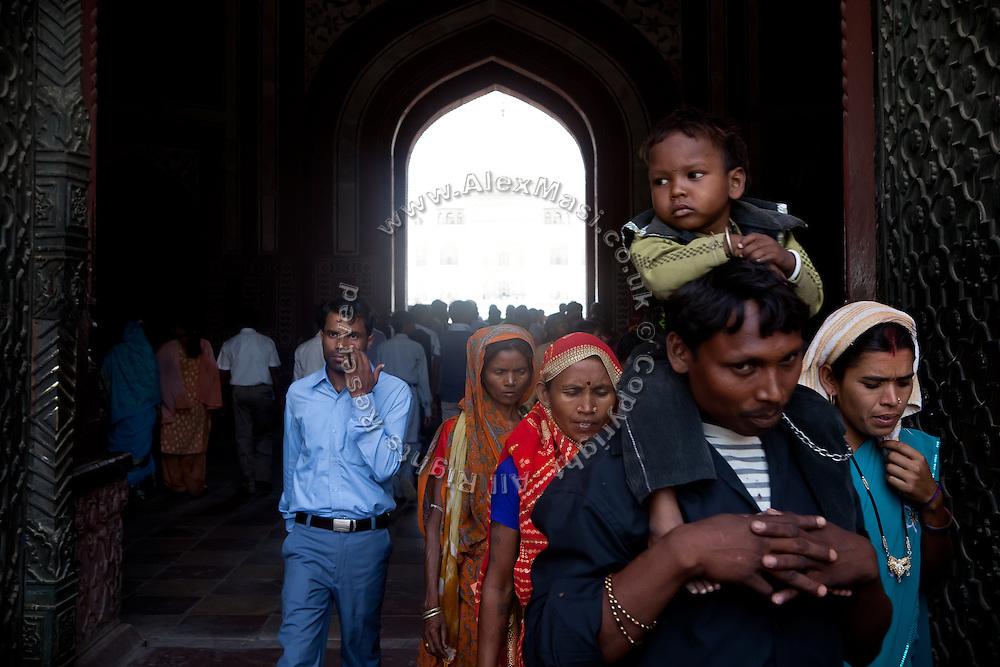 Visitors are entering the main complex of the Taj Mahal, in Agra.
