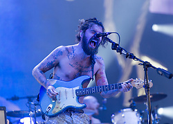 © Licensed to London News Pictures. 13/06/2014. Isle of Wight, UK.   Biffy Clyro performing live at Isle of Wight Festival .   In this picture - Simon Neil. Biffy Clyro are a Scottish rock band comprising Simon Neil (guitar/lead vocals), James Johnston (bass/vocals).  The Isle of Wight festival is an annual music festival that takes place on the Isle of Wight. Photo credit : Richard Isaac/LNP