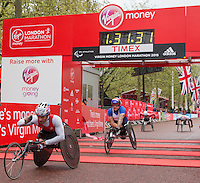 Joshua George of the USA crosses the line to win the Elite Mens wheelchair race at the Virgin Money London Marathon, Sunday 26th April 2015.<br /> <br /> Scott Heavey for Virgin Money London Marathon<br /> <br /> For more information please contact Penny Dain at pennyd@london-marathon.co.uk