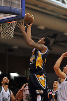 Antoine Tisby looks to dunk, in  the NBL match, between the Otago Nuggets and Manawatu Jets, Lion Foundation Arena, Edgar Centre, Dunedin, Otago, New Zealand, Saturday, June 8, 2013. Credit: Joe Allison / Allison Images
