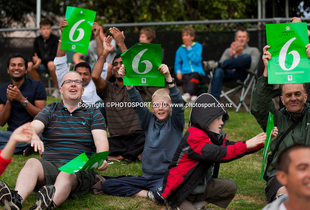Fans in the crowd celebrate a six during New Zealand Black Caps v Pakistan, Match 2, won by NZ by 39 runs. Twenty 20 Cricket match at Seddon Park, Hamilton, New Zealand. Tuesday 28 December 2010. . Photo: Stephen Barker/PHOTOSPORT